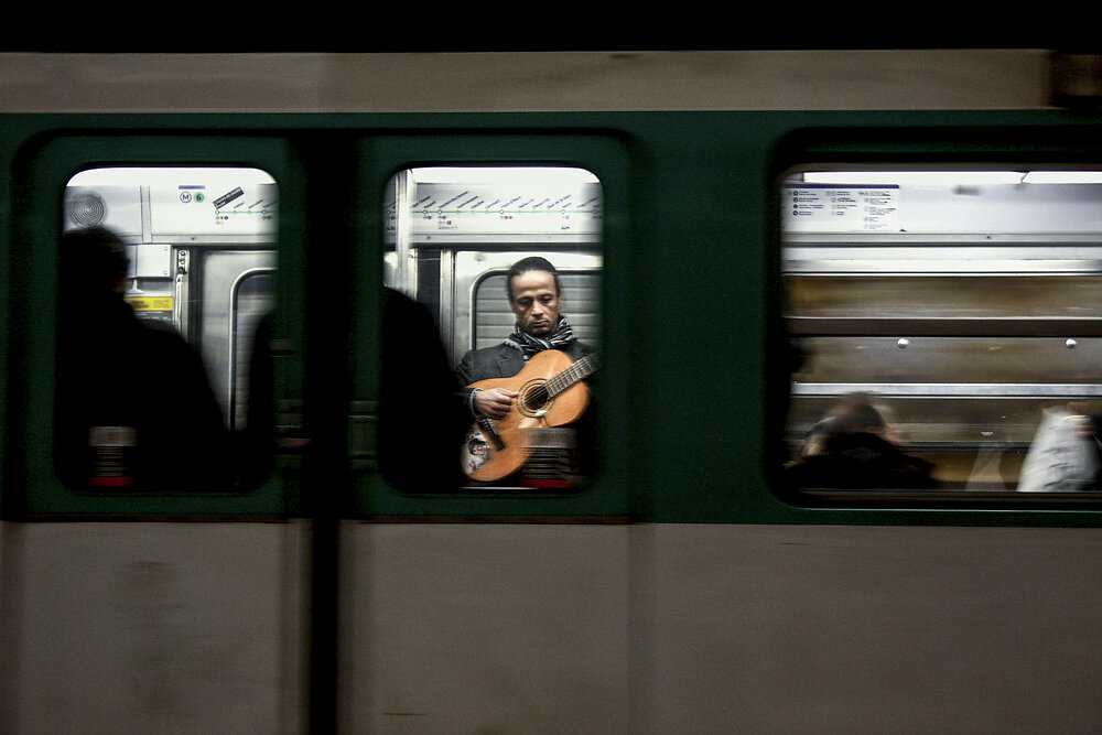 A street musician playing in a metro in Paris, 2011.